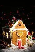 Gingerbread house on dark background