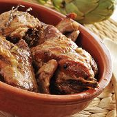 closeup of an earthenware bowl with spanish roast rabbit