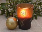 stock photo of piety  - Decorative candles and mistletoe on the table. ** Note: Visible grain at 100%, best at smaller sizes - JPG