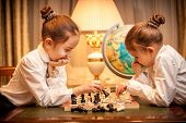 Girls In School Uniform Playing Chess