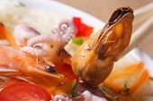 Mussel Without Shell Close Up In Asian Soup