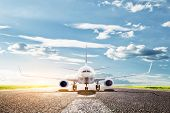 Airplane ready to take off from runway. A big passenger or cargo aircraft, airline. Transport, transportation, travel
