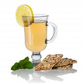 Tea with biscuits, lemon and mint isolated