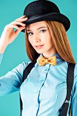 stock photo of bow tie hair  - Elegant girl model poses in blouse - JPG