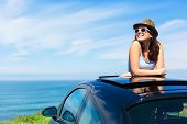 Woman On Summer Vacation Leaning Out Sunroof