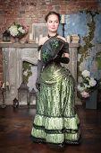 Beautiful Woman In Medieval Dress With Fan
