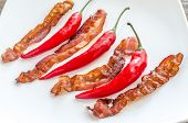 Fried Bacon Strips With Chili Pepper