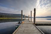 picture of morning  - The morning light on the dock with a canoe by it on Chatcolet Lake near Plummer Idaho - JPG