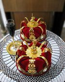 Golden crowns and a glass of wine for orthodox wedding