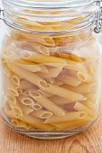 Dried Pasta Tubes In A Glass Jar
