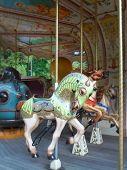 stock photo of carousel horse  - French carousel with horses in the park - JPG