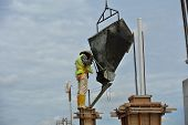 Construction workers casting column