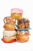 Chocolate eclairs- Krapfen or donuts with isolated White background