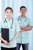 picture of mongolian  - Vertical view of mongolian and asian doctors