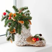 Christmas Arrangement Of Felt Boot Decorated With Toys.