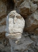 Stone face on the rocks