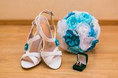 Close Up Of Wedding Bouquet And Bride's Shoes And Gold Rings