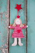 Sewn angel doll hanging