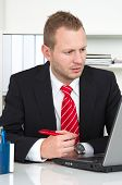 Businessman working on laptop and concentrating