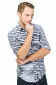 Young man standing and thinking-isolated over white background
