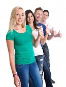 Good teamwork - thumbs up and happy isolated on white background - young men and woman