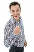 Successful attractive young business man holding fist up isolated on white background