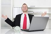 stock photo of rep  - Successful businessman laughing with hands up and laptop  - JPG