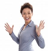 Successful businesswoman in blue turning towards camera with hand gesture isolated on white background
