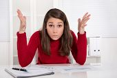Hands up - young businesswoman has concentration problems at studying or at work