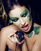 woman with creative make up like snake and rat in her hands, hal