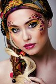 stock photo of fine art portrait  - portrait of contemporary noblewoman with face art creative close up, pattern russian style