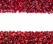 Scattered From The Top And Bottom Pomegranate Seeds, Can Be Used As A Background, Isolated On A Whit