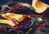 Ripe Cranberries And Sliced Pumpkin