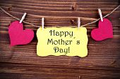 foto of two hearts  - Yellow Tag Or Label With Two Hearts On A Line With Happy Mothers Day On Wooden Background Two Symbols Vintage Retro And Old Fashion Style With Frame - JPG