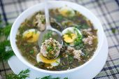 picture of sorrel  - sorrel soup with meatballs and eggs in a bowl