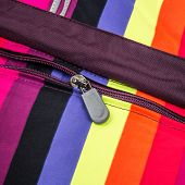 Close up zipper on a colorful background