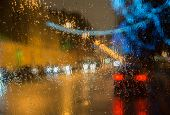 Wet  Car Window With Background Of The Night City