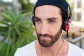 Man With Beard Listening To Music On Headphones