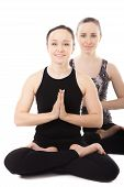 Two Yogi Female Partners In Yoga Lotus Pose