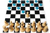 picture of adversity humor  - Chess and checkers against each other on one board - JPG