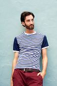 Male Fashion Model Leaning Against Wall With Striped Shirt