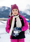 picture of snowball-fight  - Portrait of cute girl playing in snowballs on top of high mountain - JPG
