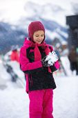 stock photo of snowball-fight  - Beautiful smiling girl posing against high mountains with snowball - JPG