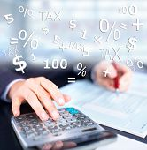 stock photo of calculator  - Hands of accountant businessman with calculator - JPG