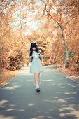 A Cute Asian Thai Girl Is Walking On A Forest Path Alone In Soft Vintage Color Style