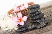 Spa With Black Stones And Flowers