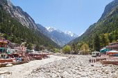image of gang  - The temple town of Gangotri in the Indian Himalayas near the source of the sacred river Ganges - JPG