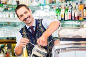 stock photo of latte  - Barista in cafe or coffee bar preparing pouring espresso shot in glass of latte macchiato - JPG