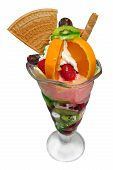 ice cream sundae with wafers, fruit, orange and whipped cream