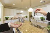 Handing Over New House Keys Inside Beautiful Custom Built Kitchen.